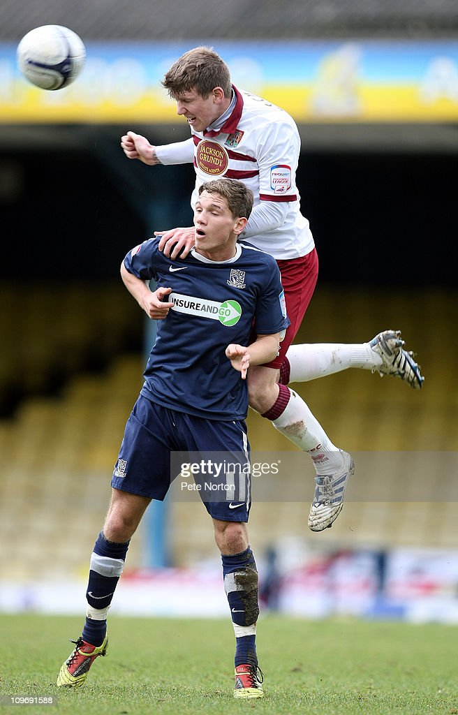 Dean Beckwith of Northampton Town rises above Lee Sawyer of Southend United to head the ball during the npower League Two match between Southend United and Northampton Town at Roots Hall on February 26, 2011 in Southend, England.