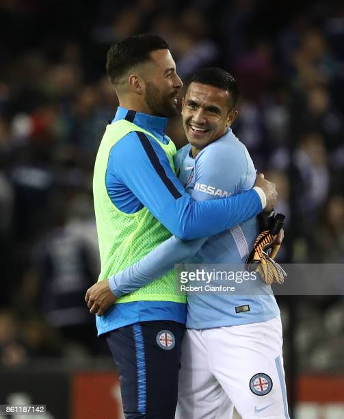Dean Bouzanis and Tim Cahill celebrate after City defeated the Victory during the round two ALeague match between Melbourne Victory and Melbourne...