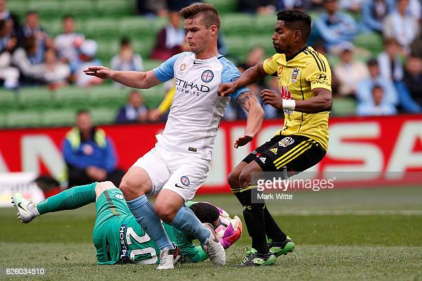 Dean Bouzanis of Melbourne City dives to save a goal during the round eight ALeague match between Melbourne City and Wellington Phoenix at AAMI Park...