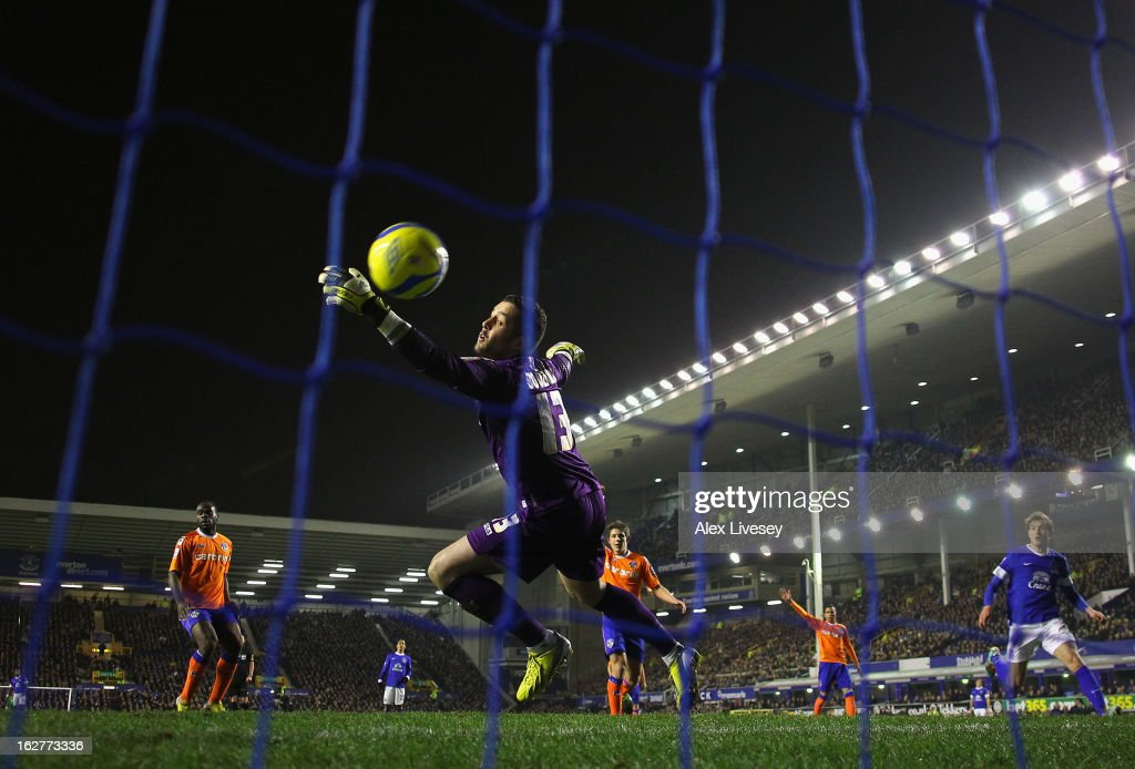 Dean Bouzanis of Oldham Athletic is beaten by <a gi-track='captionPersonalityLinkClicked' href=/galleries/search?phrase=Kevin+Mirallas&family=editorial&specificpeople=745704 ng-click='$event.stopPropagation()'>Kevin Mirallas</a> of Everton (not pictured) for the opening goal during the FA Cup fifth round replay match between Everton and Oldham Athletic at Goodison Park on February 26, 2013 in Liverpool, England.