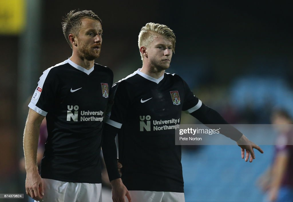 Dean Bowditch and George Smith of Northampton Town line up to defend a free kick during the Emirates FA Cup First Round Replay match between Scunthorpe United and Northampton Town at Glanford Park on November 14, 2017 in Scunthorpe, England.