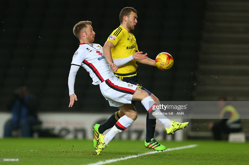 Dean Bowditch of MK Dons and Ben Gibson of Middlesbrough during the Sky Bet Championship match between MK Dons and Middlesbrough at Stadium mk on February 9, 2016 in Milton Keynes, England.