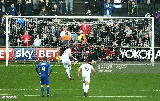 Dean Bowditch of MK Dons scores his sides first goall from the penalty spot during the Sky Bet League One match between Milton Keynes Dons and AFC...