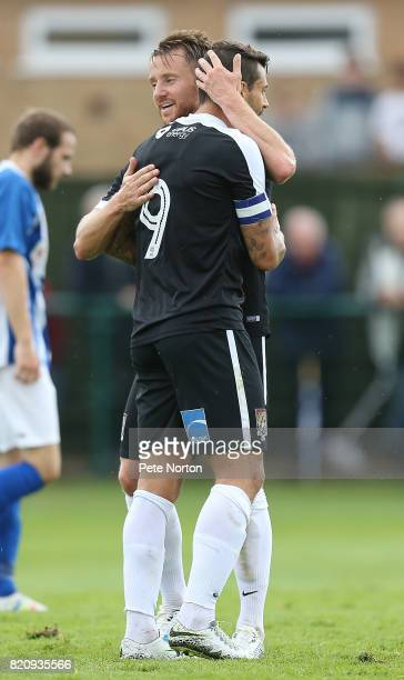Dean Bowditch of Northampton Town celebrates with Marc Richards after scoring his sides goal during the PreSeason Friendly match between Kettering...