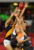 Dean Brogan and Andrew Phillips of the Giants compete for the ball during the round 12 AFL match between the Greater Western Sydney Giants and the...