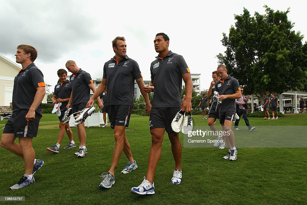 Dean Brogan and Israel Folau of the Giants walk during the Greater Western Sydney Giants AFL Team Photo Session at Village Green on February 9 2012...