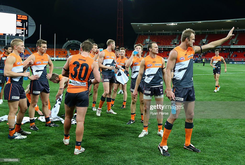Dean Brogan and James McDonald of the Giants thank the crowd after the round 23 AFL match between the Greater Western Sydney Giants and the North...