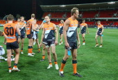 Dean Brogan and James McDonald of the Giants walk from the ground after the round 23 AFL match between the Greater Western Sydney Giants and the...