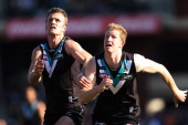 Dean Brogan and Matthew Lobbe of the Power goes for the ball during the round 24 AFL match between the Port Adelaide Power and the Melbourne Demons...