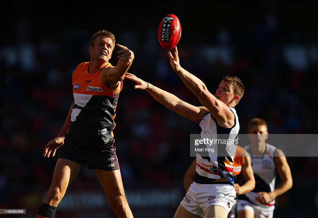 Dean Brogan of the Giants challenges Josh Jenkins of the Crows during the round 16 AFL match between the Greater Western Sydney Giants and the...