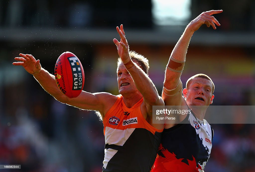 Dean Brogan of the Giants competes for the ball against Sam Jacobs of the Crows during the round seven AFL match between the Greater Western Sydney...