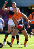 Dean Brogan of the Giants handballs during the round seven AFL match between the Greater Western Sydney Giants and the Adelaide Crows at Skoda...