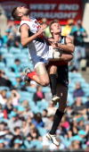 Dean Brogan of the Power and Mark Jamar of the Demons compete in the ruck during the round 21 AFL match between Port Power and the Melbourne Demons...