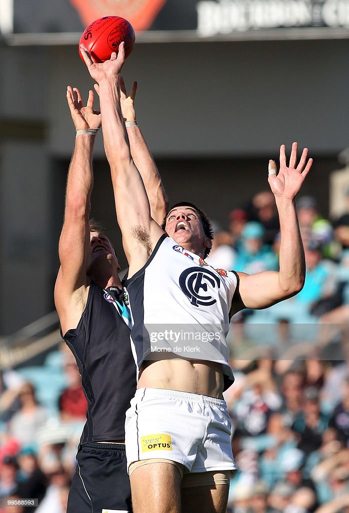 Dean Brogan of the Power and Matthew Kreuzer of the Blues contest for the ball during the round eight AFL match between the Port Adelaide Power and...