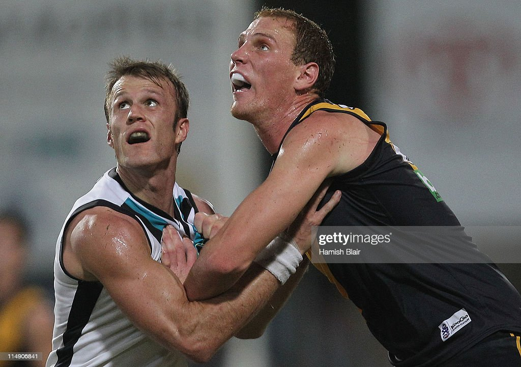 Dean Brogan of the Power contests ruck with Andrew Browne of the Tigers during the round 10 AFL match between the Richmond Tigers and the Port...