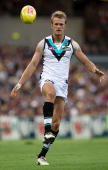 Dean Brogan of the Power kicks the ball during the round two AFL match between the West Coast Eagles and Port Adelaide Power at Subiaco Oval on April...