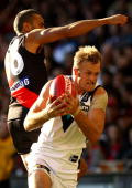 Dean Brogan of the Power marks infront of Jarrod Atkinson of the Bombers during the round seven AFL match between the Essendon Bombers and the Port...