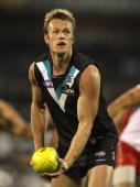 Dean Brogan of the Power passes the ball during the round 12 AFL match between the Port Adelaide Power and the Sydney Swans at AAMI Stadium on June...