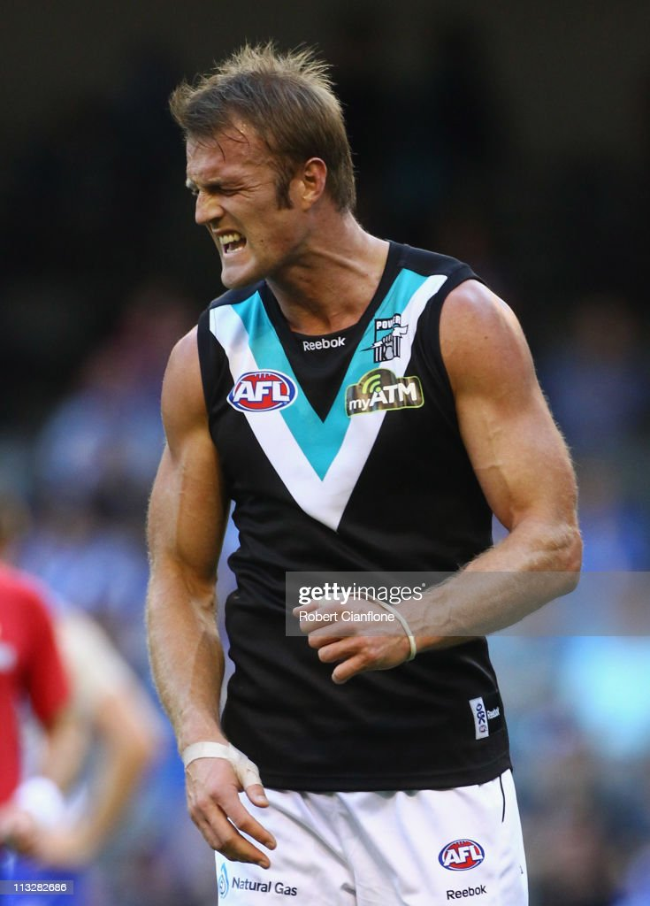 Dean Brogan of the Power reacts after missing a shot on goal during the round six AFL match between the North Melbourne Kangaroos and the Port...