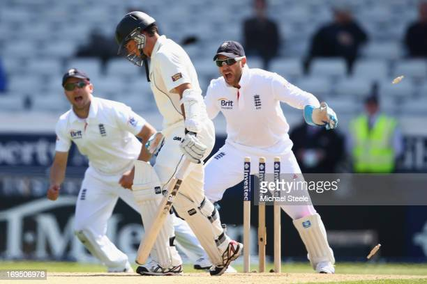 Dean Brownlie of New Zealand is bowled by Graeme Swann as wicketkeeper Matt Prior and Jonathan Trott of England join in with the celebrations during...