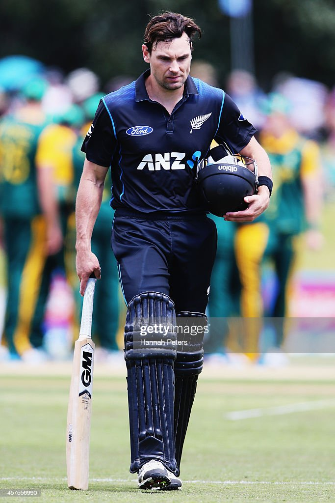Dean Brownlie of New Zealand walks off after being dismissed by Imran Tahir of South Africa during the One Day International match between New Zealand and South Africa at Bay Oval on October 21, 2014 in Mount Maunganui, New Zealand.