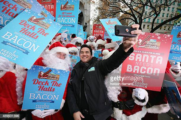 Dean Cain and Farmland rally with Santa Claus in Herald Square Park pledging #BaconForSanta to help fight hunger this holiday season with Feeding...