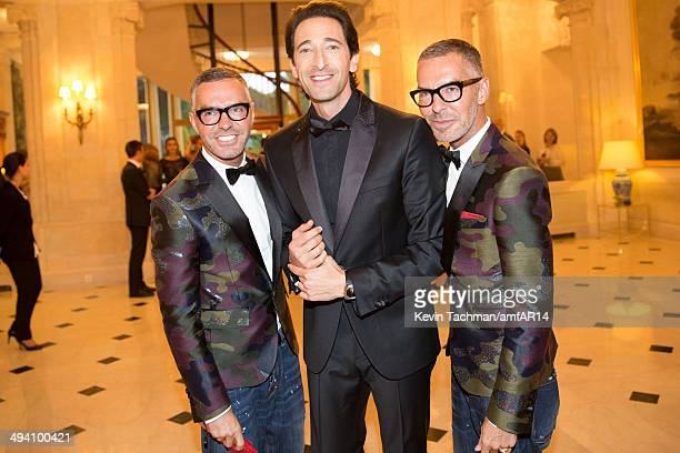 Dean Caten and Dan Caten and Adrien Brody attend amfAR's 21st Cinema Against AIDS Gala presented by WORLDVIEW BOLD FILMS and BVLGARI at Hotel du...