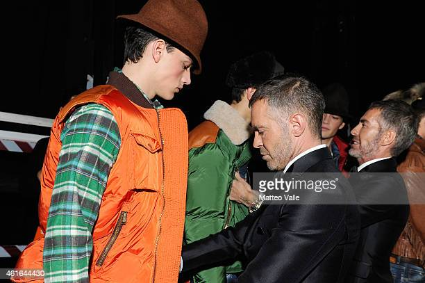 Dean Caten and Dan Caten are seen during the Dsquared2 Show backstage as a part of Milan Menswear Fashion Week Fall Winter 2015/2016 on January 16...