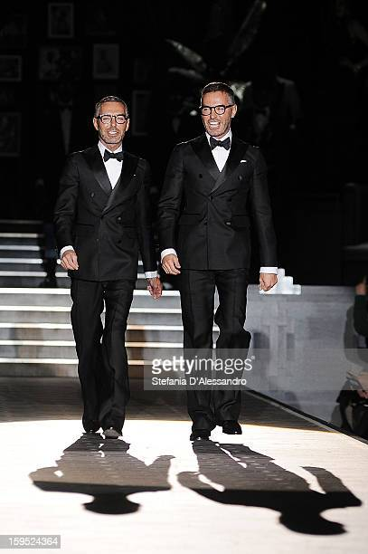 Dean Caten and Dan Caten walk the runway after the DSquared2 show as part of Milan Fashion Week Menswear Autumn/Winter 2013 on January 15 2013 in...