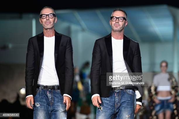 Dean Caten and Dan Caten walk the runway after the DSquared2 show as part of Milan Fashion Week Womenswear Spring/Summer 2015 on September 18 2014 in...