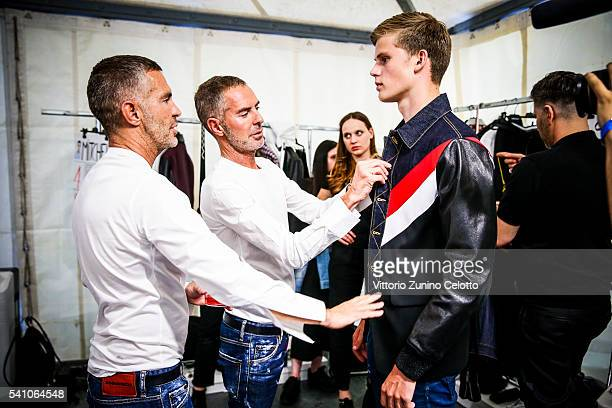 Dean Caten Dan Caten and a model are seen backstage ahead of the Dsquared2 show during Milan Men's Fashion Week Spring/Summer 2017 on June 17 2016 in...