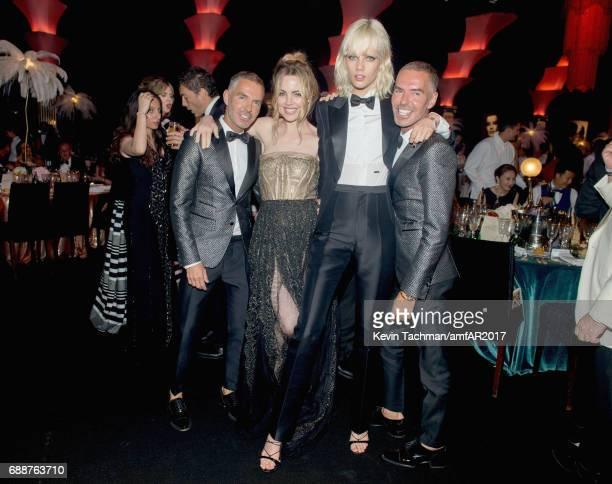 Dean Caten Marjan Jonkman and Dan Caten attend the amfAR Gala Cannes 2017 at Hotel du CapEdenRoc on May 25 2017 in Cap d'Antibes France