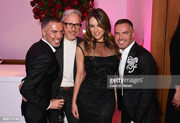 Dean Caten Patrick Cox Elizabeth Hurley and Dan Caten attend a private view of 'Vogue 100 A Century of Style' hosted by Alexandra Shulman and Leon...