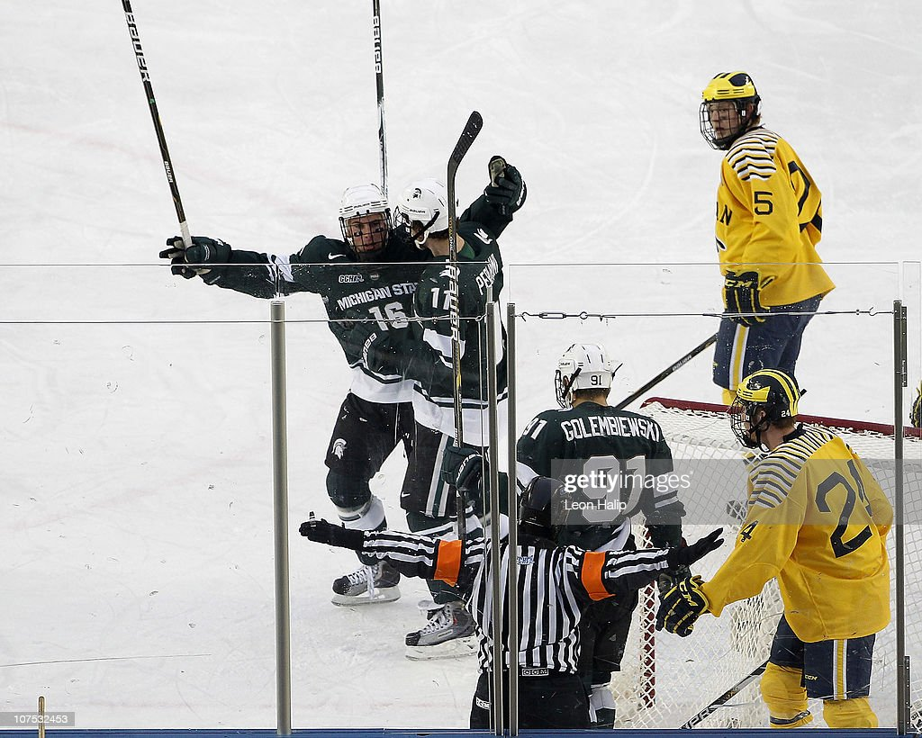 Dean Chelios #16 of the Michigan State Spartans celebrates a second period goal that was waved off by the referee during the game against the Michigan Wolverines at the Big Chill game at Michigan Stadium on December 11, 2010 in Ann Arbor, Michigan. The Wolverines defeated the Spartand 5-0.