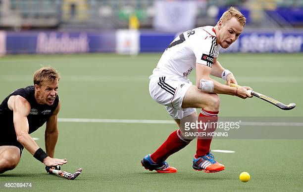 Dean Couzins of New Zealand fights for the ball with Christopher Ruhr of Germany during a stage match between New Zealand and Germany in the men's...