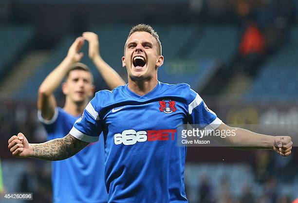 Dean Cox of Leyton Orient celebrates after the final whistle after his side won the Capital One Cup second round match between Aston Villa and Leyton...