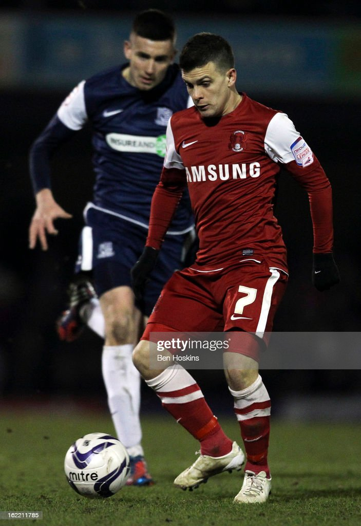 Dean Cox of Leyton Orient passes ahead of Ben Reeves of Southend during the Johnstone's Paint Trophy Southern Section Final match between Southend United and Leyton Orient at the Roots Hall Stadium on February 20, 2013 in Southend, England.