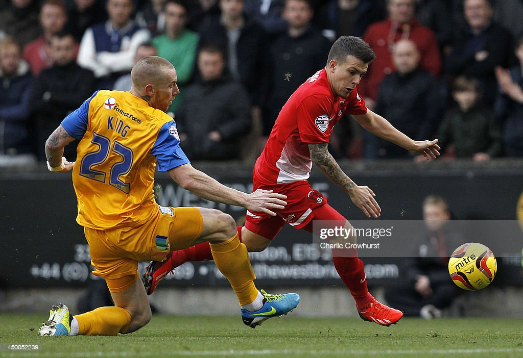 Dean Cox of Leyton Orient (R) skips round Jack King of Preston during the Sky Bet League One match between Leyton Orient and Preston North End at The Matchroom Stadium on November 16, 2013 in London, England.