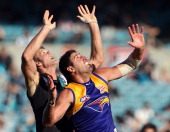 Dean Cox of the Eagles and Dean Brogan of the Power compete in the ruck during the round two AFL match between Port Adelaide Power and the West Coast...
