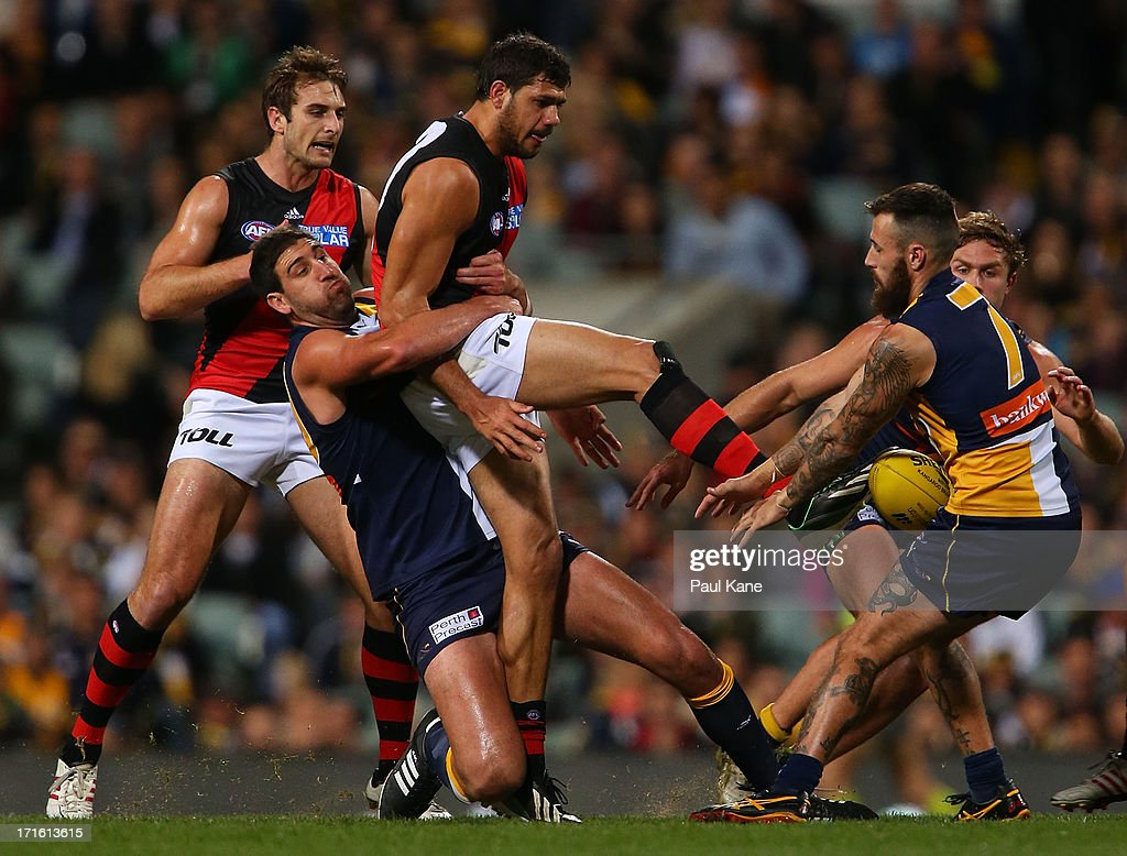 Dean Cox of the Eagles tackles Patrick Ryder of the Bombers during the round 14 AFL match between the West Coast Eagles and the Essendon Bombers at Patersons Stadium on June 27, 2013 in Perth, Australia.