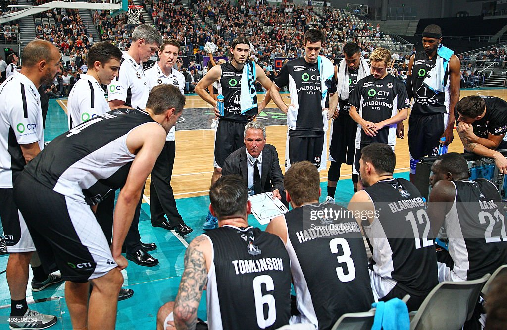 Dean Demopoulos the coach of United speaks to his players during a time out during the round three NBL match between Melbourne United and the...