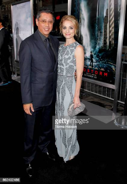 Dean Devlin and Lisa Brenner attend the premiere of Warner Bros Pictures 'Geostorm' at TCL Chinese Theatre on October 16 2017 in Hollywood California