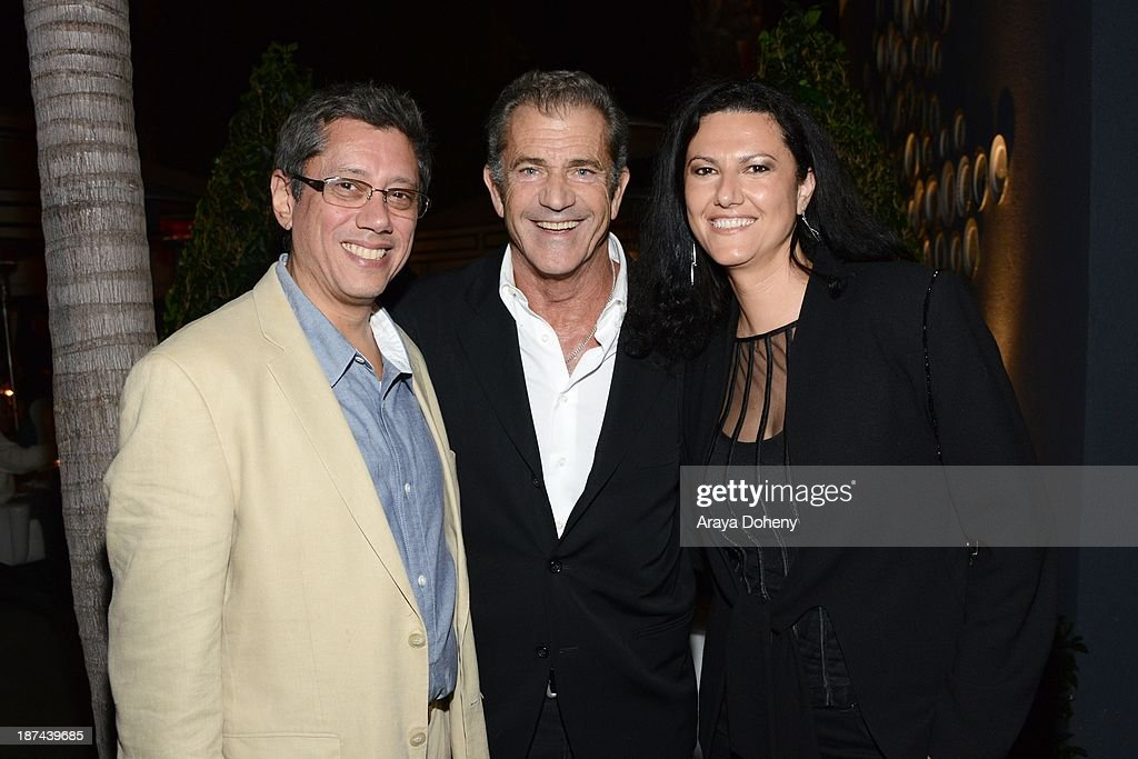 Dean Devlin, Mel Gibson and Sonia Mehandjiyska attend the Electric Entertainment AFM Party at the Viceroy Hotel on November 8, 2013 in Santa Monica, California.