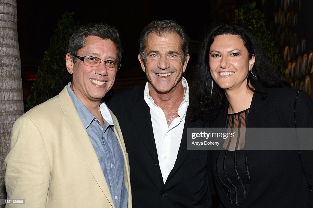 <a gi-track='captionPersonalityLinkClicked' href=/galleries/search?phrase=Dean+Devlin&family=editorial&specificpeople=540462 ng-click='$event.stopPropagation()'>Dean Devlin</a>, <a gi-track='captionPersonalityLinkClicked' href=/galleries/search?phrase=Mel+Gibson&family=editorial&specificpeople=201512 ng-click='$event.stopPropagation()'>Mel Gibson</a> and Sonia Mehandjiyska attend the Electric Entertainment AFM Party at the Viceroy Hotel on November 8, 2013 in Santa Monica, California.