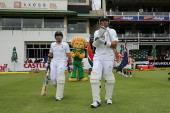 Dean Elgar and Graeme Smith of South Africa take to the field during day one of the Second Test match between South Africa and Australia at AXXESS St...