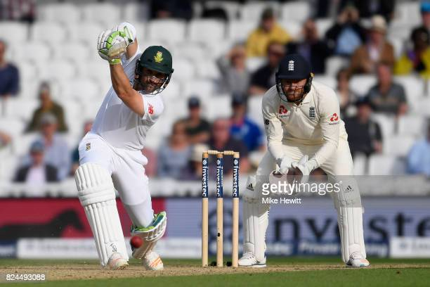 Dean Elgar of South Africa in action as wicketkeeper Jonny Bairstow of England looks on during Day Four of the 3rd Investec Test between England and...