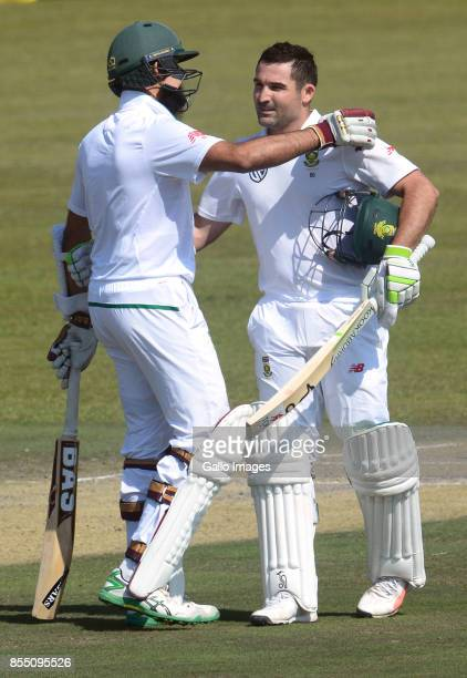 Dean Elgar of the Proteas celebrates his 100 runs with Hashim Amla of the Proteas during day 1 of the 1st Sunfoil Test match between South Africa and...