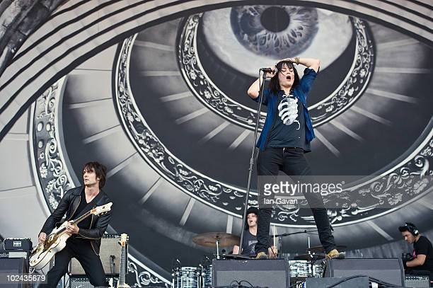 Dean Fertita Jack White and Alison Mosshart from 'The Dead Weather' perform live on the Pyramid Stage during Day 3 of the Glastonbury Festival on...
