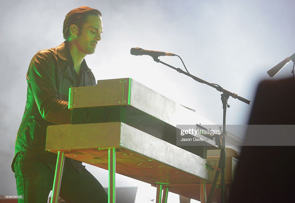 Dean Fertita of Queens of the Stone Age performs at Nashville Municipal Auditorium on October 7, 2013 in Nashville, Tennessee.