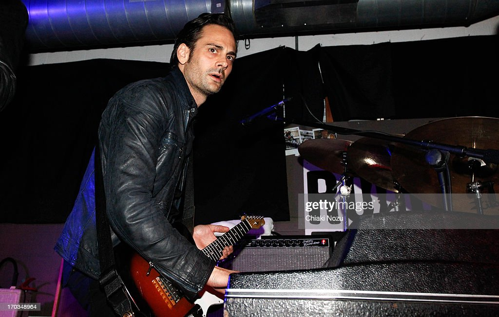 Dean Fertita of Queens of the Stone Age performs at Rough Trade East on June 11, 2013 in London, England.